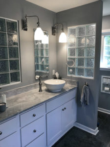 Bubble patterned glass block. Granite countertop with vessel sink.